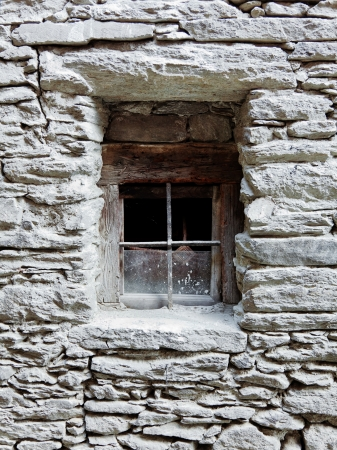 old window in stone wall photo photo