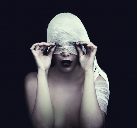scary girl: woman in bandage over black background  gothic style concept  Stock Photo