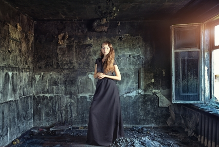 young beautiful women in grunge interior   photo