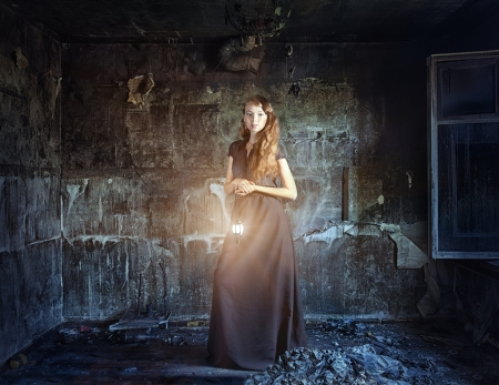 lady with the lamp: young beautiful women in grunge interior  (Photo and hand-drawing elements combined) Stock Photo