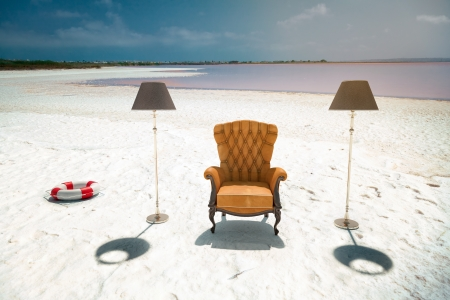 empty chair: luxury leather armchair on the beach  photo compilation concept  Stock Photo