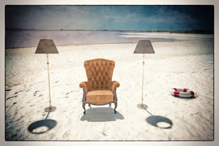 vacant: luxury leather armchair on the beach  vintage card style  Stock Photo