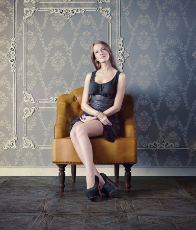beautiful woman in luxury armchair  photo