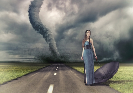 imperturbable: woman,with umbrella on the road and tornado  photo and hand-drawing elements compilation   Stock Photo