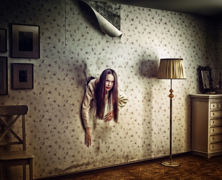 eye hole: angry woman climbs through the wall into the room  photo and hand-drawing elements compilation  texture and grain add