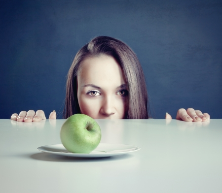 Beautiful woman with apple in front of her  Stock Photo - 17644180