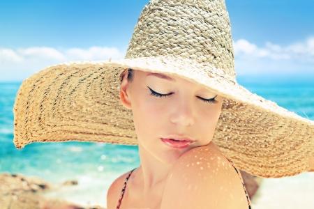 Beautiful woman on a beach on a sunny day  photo