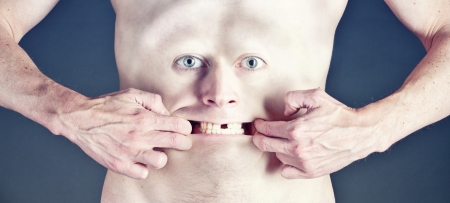 toothless: man with the face on the belly stretches mouth toothless smile