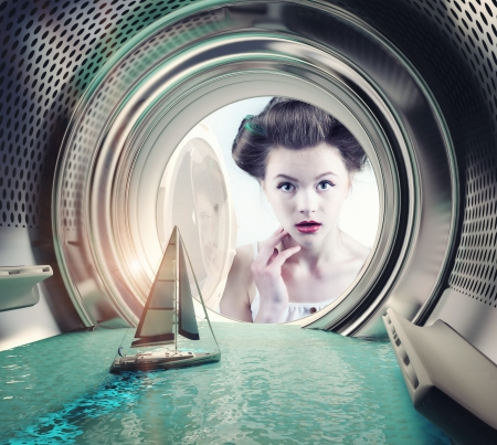 woman washing hair: Girl surprised yacht in the washing machine (creative concept)