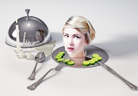 Portrait of the head of a beautiful woman standing on a dish on table  photo