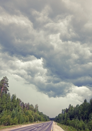 storm Clouds over road  Siberia Russia photo