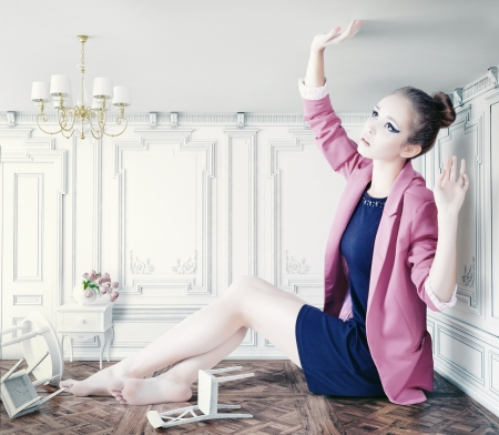 beautiful young girl in little room. creative concept photo