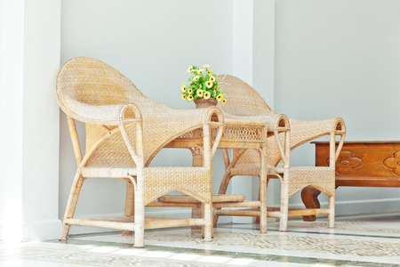 cane chair: wicker chairs outdoor sunlight scene