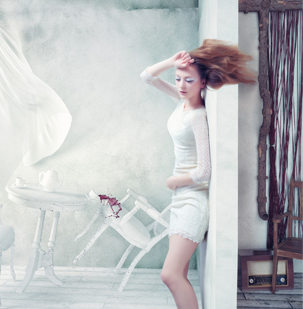 windswept: beautiful woman at the wall, windswept. creative concept