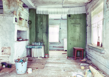 ruinous: Old small abandoned and ruinous country house interior  in Russia