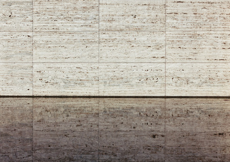 Beige textured travertine wall and reflection in a water. Barcelona Pavilion  Stock Photo