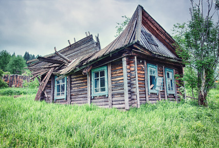 destroyed: Old small abandoned and ruinous country house in Russia