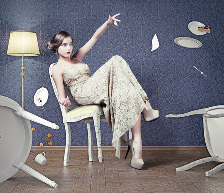 psyche:  Wicked beautiful woman girl drops the table during dinner Stock Photo