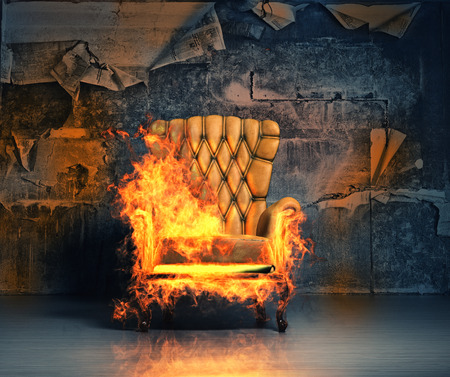 burning armchair in the grunge interior. 3D illustration creative concept
