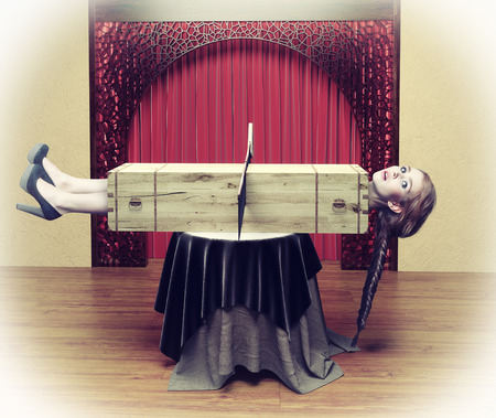 Magician sawing a woman with a saw.Photo combination concept Imagens