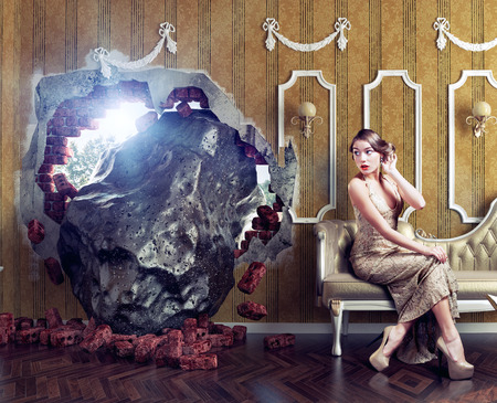 destroyed: Meteorite enters the room, scaring the woman on the sofa. Photo combination creative concept Stock Photo