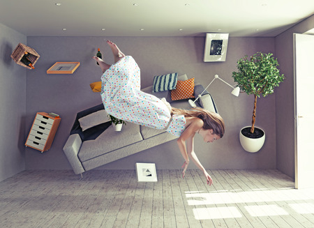 upside down: young beautiful lady fly in zero gravity room. Photo combination creative concept