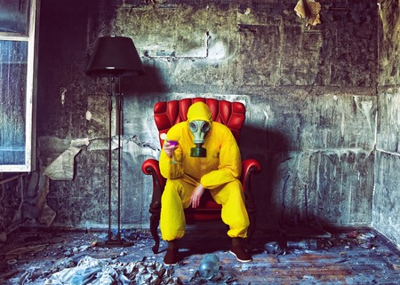 gas mask: protective overall man closed in the burnt interior. Photo combination concept