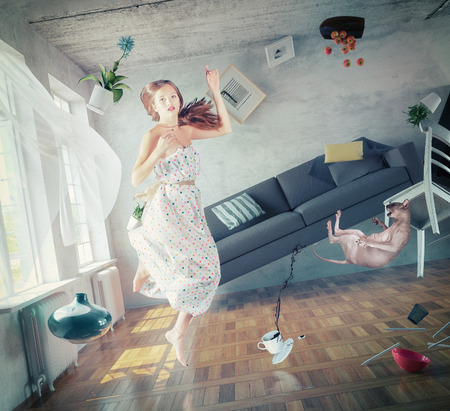 young beautiful lady fly in zero gravity room. creative concept Banco de Imagens