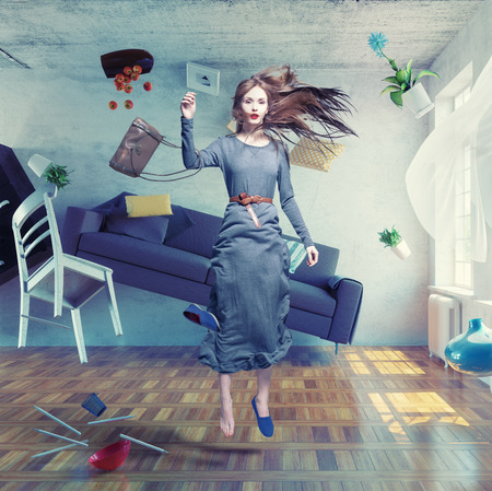 young beautiful lady fly in zero gravity room. Photo combination creative concept. Stock Photo