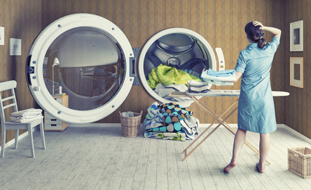dirty clothes: Woman and the Big Wash. Creative concept Stock Photo