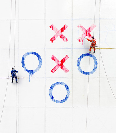 tic tac toe: Maintenance workers  play tick-tack-toe  outside a wall Stock Photo