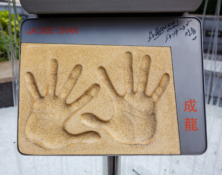 HONG KONG, CHINA - APRIL 16, 2017: Handprints and signature of Jackie Chan, a famous movie star, from Avenue of Stars
