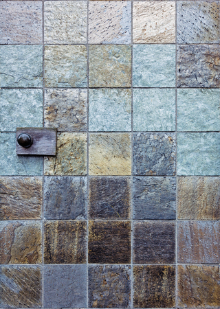the stone tile background with door knob