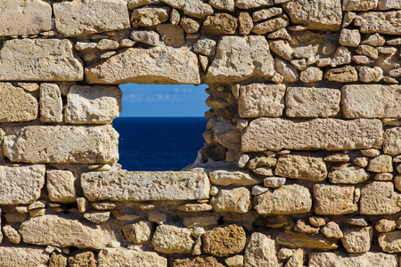 blue sky and sea in old brick wall fortress window photo Banco de Imagens