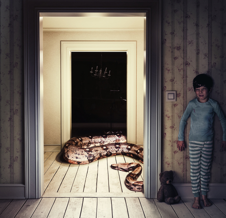 Snake in the kids room. Media mixed nightmare concept Stock Photo