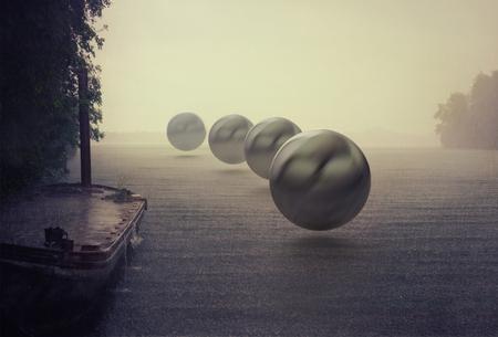 mystery spheres over the rain lake. Photocombination concept Stockfoto