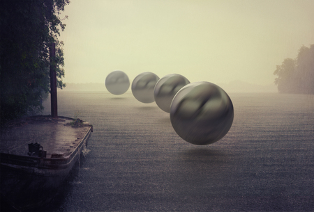 mystery spheres over the rain lake. Photocombination concept Archivio Fotografico