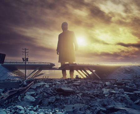 the Giant man in the destroyed city. 3d creative concept Banco de Imagens