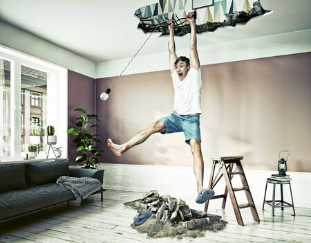 Broken ceiling and a man hanging in the hole.