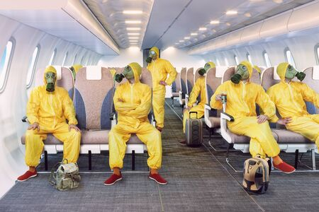 Gas mask people in the airplane interior. Standard-Bild