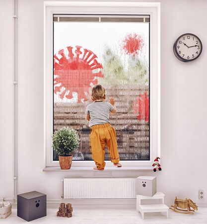 Child look out from the window. Stay home pandemic concept.