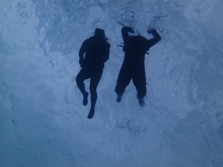 snorkelers: two swimmers having fun snorkeling in clear ocean blue water Stock Photo