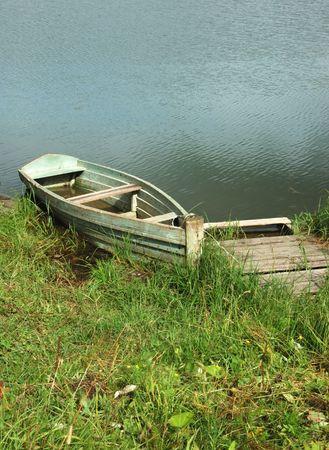 An old fishing wooden boat at berth photo