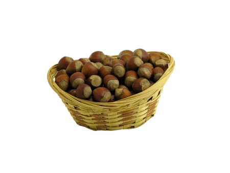 cleave: Nuts in wattled basket isolated on white