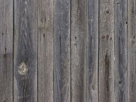 Fragment of old weathered natural wooden fence