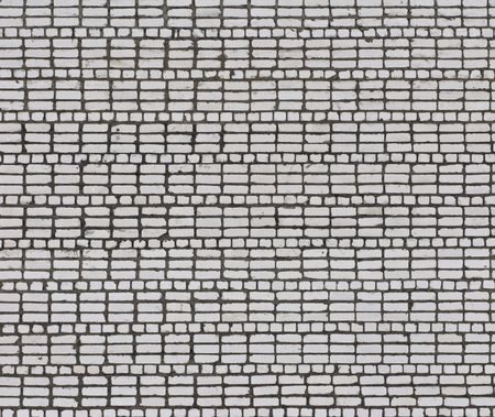 Fragment of grey brick wall texture, useful as background