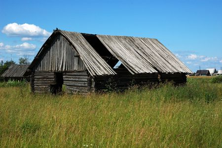 Old broken wooden shed in russian village, green grass around Stock Photo - 4664358