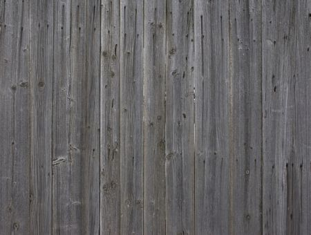 Fragment of old natural grey wooden fence