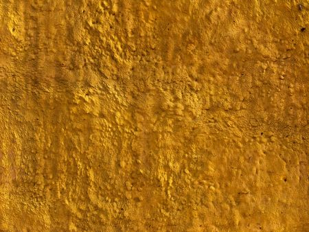 heterogeneous: Fragment of yellow concrete wall protective covering surface