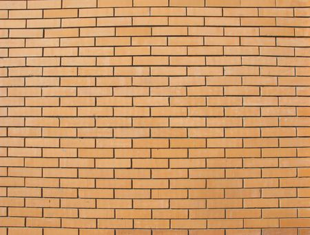 Beige colored fine brick wall texture photo